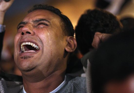 An Egyptian protester sheds some tears of joy